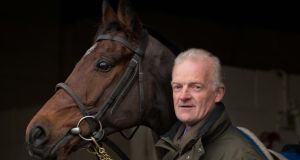 Trainer Willie Mullins with Hurricane Fly at his yard, at Closutton, Co Carlow, during a stable visit to announced the entries for the seven Grade One races at the Leopardstown Christmas Festival. Photograph: Morgan Treacy/Inpho