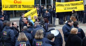 Employees of French tools and supplies retailer Castorama demonstrate to ask for the right to open the stores on Sundays. Photograph: Pierre Verdy/ AFP/Getty Images)