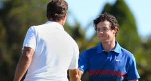 Rory McIlroy  is congratulated by home-hope Adam Scott  after clinching victory. Photograph: Getty Images