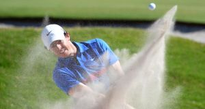 McIlroy hits out of a bunker on the way to his Australia Open success. Photograph: Inpho Rory McIlroy  hits out of a bunker on the way to winning the Australian OpenPhotograph: Getty Images