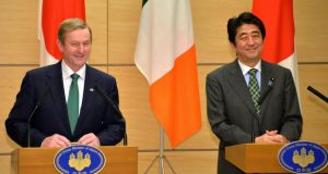 Taoiseach Enda Kenny and Japanese PM Shinzo Abe at a press conference in Tokyo yesterday. Photograph: Yoshikazu Tsuno, Pool