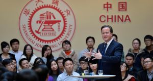 British prime minister David Cameron gestures as he delivers a speech to students at Shanghai Jiao Tong University today during his trip to China. Photograph: China Daily/Reuters.