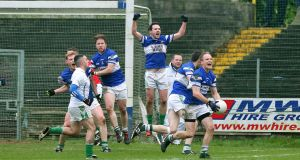 Portlaoise players celebrate their victory over Moorefield in the  Leinster club football championship semi-final at O'Moore Park, Portlaoise. Photograph: Lorraine O'Sullivan/Inpho