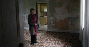 John McGahern's sister Margaret takes a moment to herself in the old barracks in Cootehall where she and the writer spent much of their childhood. Photograph: Brian Farrell