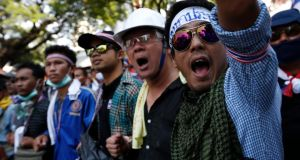 Thai anti-government protesters shout slogans during a massive rally in Bangkok today. Photograph: Rungroj Yongrit/EPA
