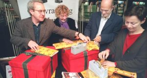 Irish writers wrap books in Waterstone's in Dublin  for a Christmas charity. Photograph: Frank Miller