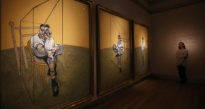 A member of Christie's staff looks at Francis Bacon's Three Studies of Lucien Freud in London prior to its sale. Photograph: Peter MacDiarmid/Getty Images