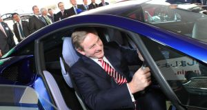 Taoiseach Enda Kenny checks out a car at the Toyota plant