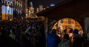 Anti-government protesters are served tea from a small booth in Independence Square. Photograph: Brendan Hoffman/Getty Images