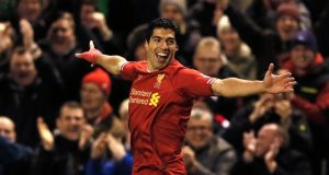 Liverpool's Luis Suarez celebrates scoring one of his four goals  against Norwich during their Premier League match at Anfield. Photograph: Phil Noble/Reuters. (