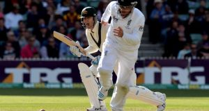 Australia's Michael Clarke (left) hits a shot past England's Ian Bell. Photograph: Anthony Devlin/PA Wire