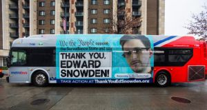 An advertisement thanking NSA leaker Edward Snowden appears on the side of a Metrobus in downtown Washington, last month. Photograph: EPA/Jim Lo Scalzo