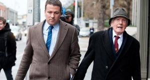 Former solicitor Ruari O Ceallaigh (left) with his father Sean O Ceallaigh (right) leaving Dublin District Court today. Photograph: Collins.