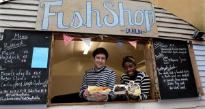 Jumoke Akintola and Peter Hogan at their Fish Shop in Blackrock Market. Photograph: Cyril Byrne