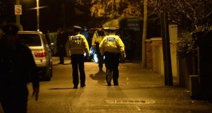 Gardaí at the scene in  Farrenboley Park, last night. Photographer: Dara Mac Dónaill / The Irish Times