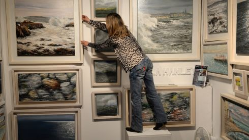 Artist Sheila Hanley oversees the presentation of her work. Photograph: Dara Mac Dónaill/The Irish Times