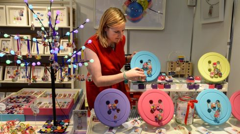 Jane Walsh, with handmade Irish jewellery at the Button Studio stand. Photograph: Dara Mac Dónaill/The Irish Times