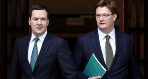 Britain's chancellor of the exchequer George Osborne and chief secretary to the treasury Danny Alexander leave for the House of Commons ahead of the dilivery of the annual autumn financial statement.