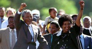 Nelson Mandela (front L), accompanied by his wife Winnie, walks out of the Victor Verster prison, near Cape Town, after spending 27 years in apartheid jails in this February 11, 1990 file photo. Photograph: Juda Ngwenya/Files/Reuters.
