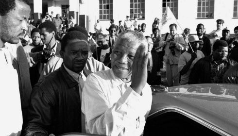 Nelson Mandela waved to supporters after he voting in South Africa's first post-Apartheid election, near Durban, April 27, 1994. Photograph: Ozier Muhammad/The New York Times