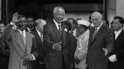 Nelson Mandela is flanked by Deputy presidents Thabo Mbeki, left, and FW de Klerk following their inauguration in Pretoria, South Africa, on May 9, 1994. Photograph: Ozier Muhammad/The New York Times