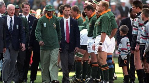 Nelson Mandela walking past Francois Pienaar in the line up before the Rugby World Cup Final in Johannesburg. John Stillwell/PA Wire