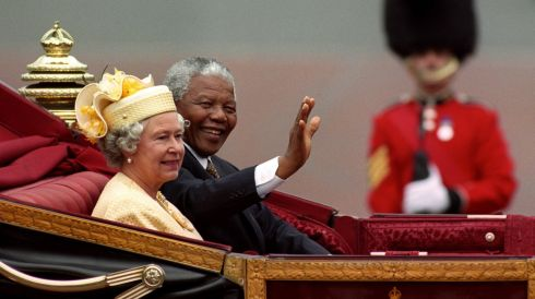Mandela and Queen Elizabeth ride in a carriage in London. David Cheskin/PA Wire
