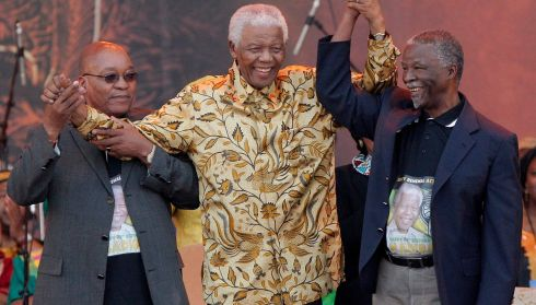 Mandela (C), celebrating with South African President, Thabo Mbeki (R) and ANC party president, Jacob Zuma (L) .  EPA/KIM LUDBROOK
