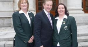 An Taoiseach, Enda Kenny, with Irish Ladies' Flyfishing captain Julie Gerry (left) and team member Jenny Casey at the photocall in Government Buildings to acknowledge their win in the 2013 Home International