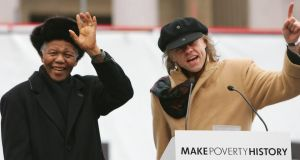 Nelson Mandela  waves to the crowd with  Bob Geldof during a mass rally in Trafalgar Square on February 3rd, 2005