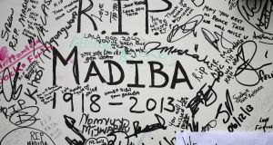 Messages written by mourners are seen outside the residence of former South African president Nelson Mandela in Johannesburg. Photograph: Siphiwe Sibeko/Reuters