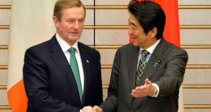 Taoiseach Enda Kenny shakes hands with Japanese prime minister Shinzõ Abe in Tokyo last Monday. Photograph: Yoshikazu Tsuno/AP.