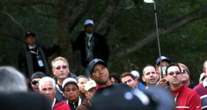 Tiger Woods watches his chip shot on the fifth hole during yesterday's second round of the World Challenge at Sherwood Country Club in California. Photograph: Stephen Dunn/Getty Images