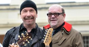 The Edge and Paul McGuinness. He announced last month that he was leaving the band. Photograph: Dara Mac Donaill / The Irish Times