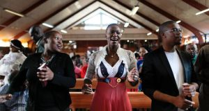 Worshippers sing and dance today during a baptism at Regina Mundi Catholic church in Soweto, near the former house of the late South African president Nelson Mandela in Johannesburg, South Africa. Photograph: Dai Kurokawa/EPA