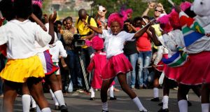 A girl dances today on Vilakazi Street in Soweto, where the former South African President Nelson Mandela resided when he lived in the township. Photograph: Siphiwe Sibeko/Reuters