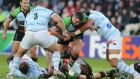 Nick Easter is challenged by France's Racing Metro 92 Luc Ducalcon, left, and Karim Ghezal at the Stade de la Beaujoire in Nantes.