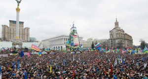 People attend a rally organised by supporters of EU integration. Photograph: Gleb Garanich/Reuters
