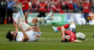 Munster's Conor Murray was replaced in the first half after being tackled by Jean-Pierre Perez of Perpignan. Photograph: Dan Sheridan/Inpho