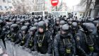 Riot police line in front of the presidential office during an opposition rally in Kiev, Ukraine. Photograph: Sergey Dolshenko/EPA