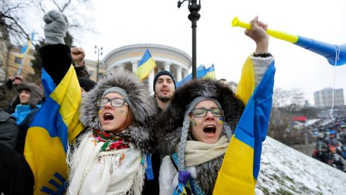 Ukrainian girls shout slogans during the pro-European rally on Independence Square in Kiev. Photograph: Sergey Dolshenko/EPA