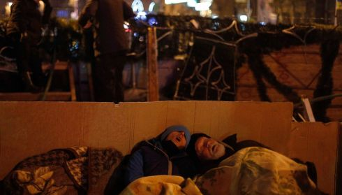 Protesters sleep together near an Independence Square barricade. Photograph: Stoyan Nenov/Reuters