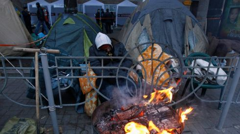 Camping on the streets of Kiev with a brazier for heat. Photograph: Vasily Fedosenko/Reuters
