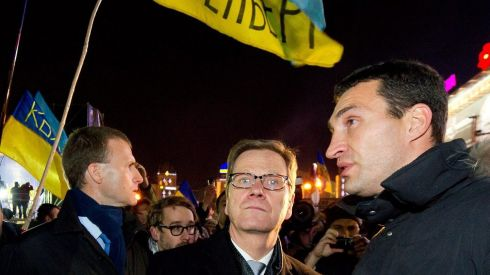 German foreign minister Guido Westerwelle (centre) discussing the ongoing political standoff with Ukrainian professional boxer  Wladimir Klitschko (right) on Independence Square in Kiev. Mr Westerwelle was in Kiev to attend Organisation for Security and Cooperation in Europe (OSCE) discussions and hold talks with Ukrainian officials. Photograph: Tim Brakemeier/EPA