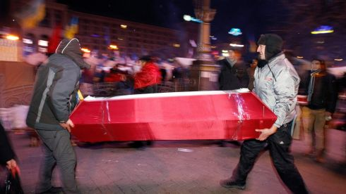 Pro-EU activists carry a mock coffin to demonstrate against President Victor Yanukovich at Independence Square in Kiev. Photograph: Vasily Fedosenko/Reuters