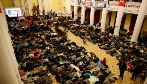 Protesters rest in Kiev's City Hall after it was converted into an organisational hub for their activities.  Photograph: Stoyan Nenov/Reuters