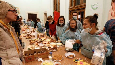Volunteers distribute food to pro-EU protesters in City Hall. Photograph: Vasily Fedosenko/Reuters