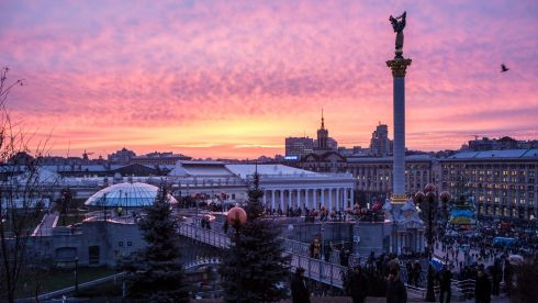 The sun sets over Independence Square on December 4th, 2013 in Kiev. Photograph: Brendan Hoffman/Getty Images