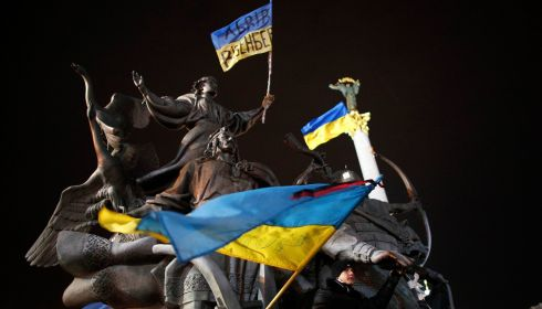 Dressing up an iconic statue in Independence Square. Photoraph: Stoyan Nenov/Reuters