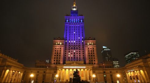 The Palace of Culture and Science is illuminated in Ukraine's national colours of blue and yellow in Warsaw, Poland, on December 4th, 2013. The action is in support of Ukrainian anti-government protesters in Kiev. Photograph: Leszek Szymanski/EPA